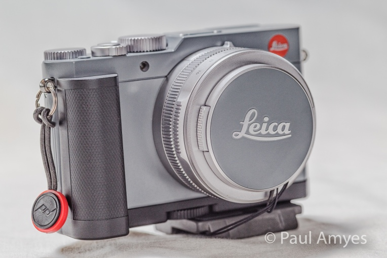 My Leica D-Lux pimped out with its accessory grip, tripod adapter and Peak Designs Anchor Link.